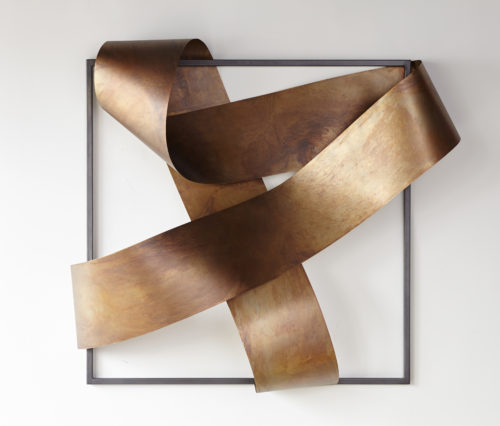 Brass undulating framed